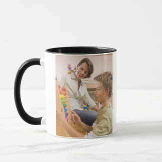 Mother and son using abacus mug