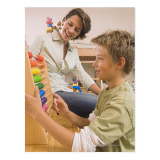 Mother and son using abacus postcard