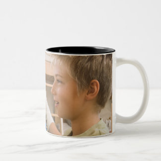 Mother and son using abacus Two-Tone coffee mug