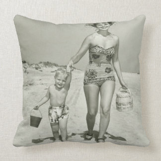 Mother and Son Walking Throw Pillows