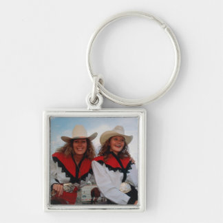Mother and teenage daughter (14-16) at rodeo, keychain