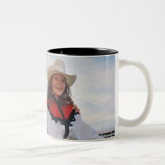 Mother and teenage daughter (14-16) at rodeo, Two-Tone coffee mug