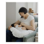 Mother breast feeding baby girl poster