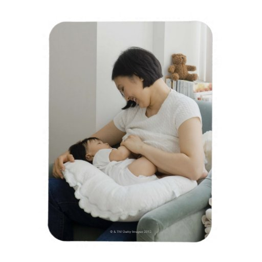 Mother breast feeding baby girl rectangular photo magnet
