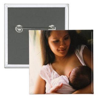 Mother breast feeding newborn pinback button