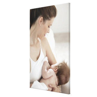 Mother breastfeeding baby 2 stretched canvas print