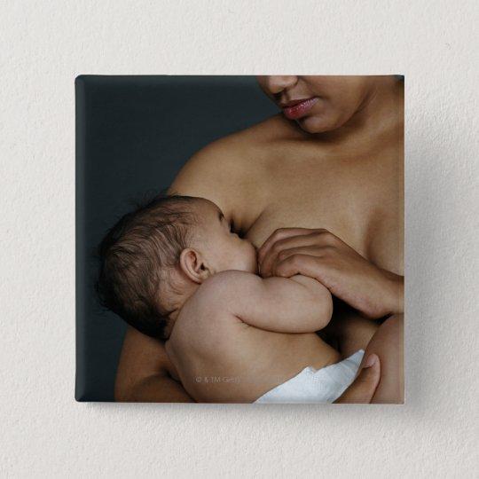 Mother breastfeeding baby boy (6-11 months) pinback button