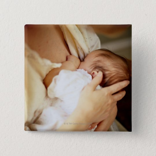 Mother breastfeeding baby girl (1-3 months) button