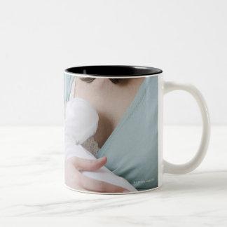 Mother breastfeeding baby mug
