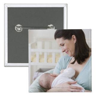 Mother breastfeeding baby pinback button
