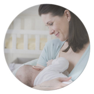 Mother breastfeeding baby plate