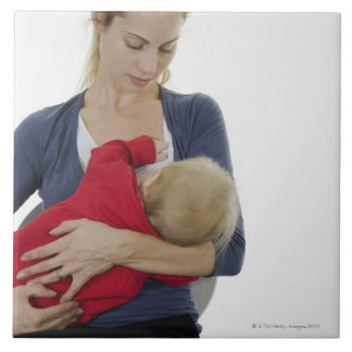 Mother breastfeeding her baby. large square tile