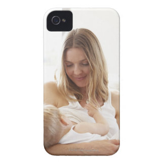 Mother breastfeeding her child iPhone 4 cover