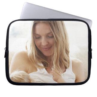 Mother breastfeeding her child laptop computer sleeve