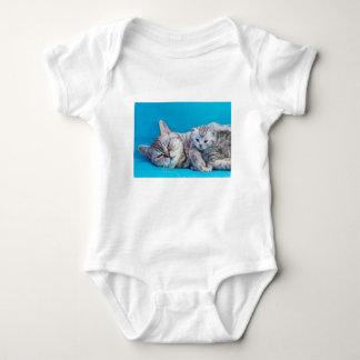 Mother cat lying with kitten on blue garments baby bodysuit