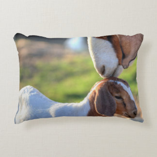 Mother goat kissing her baby on head. decorative pillow