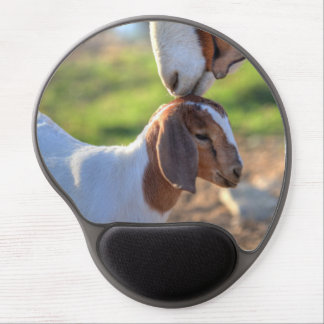 Mother goat kissing her baby on head. gel mouse mat
