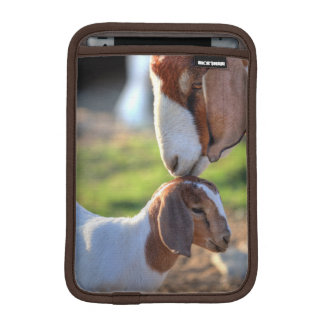 Mother goat kissing her baby on head. iPad mini sleeves