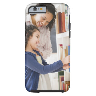 Mother helping daughter choose book on shelf iPhone 6 case