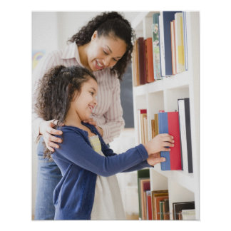 Mother helping daughter choose book on shelf poster