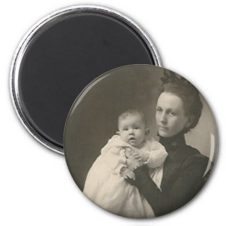 mother holding baby 2 inch round magnet