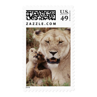 Mother lion sitting with her cub postage