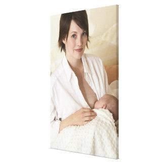 Mother nursing baby canvas print