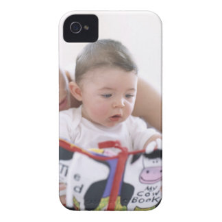 Mother reading to baby boy. Faces of a mother iPhone 4 Cover