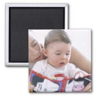 Mother reading to baby boy. Faces of a mother Magnets