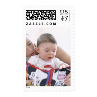 Mother reading to baby boy. Faces of a mother Postage