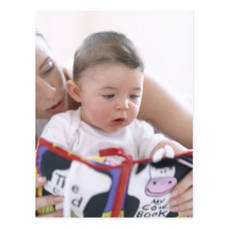 Mother reading to baby boy. Faces of a mother Postcard
