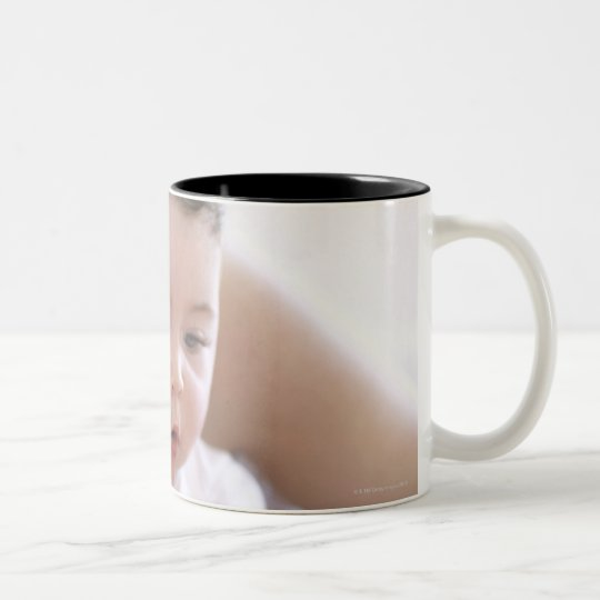 Mother reading to baby boy. Faces of a mother Two-Tone Coffee Mug