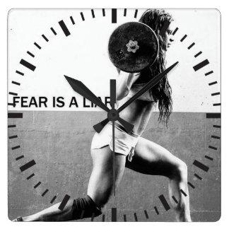 Motivación del gimnasio del entrenamiento de la reloj cuadrado