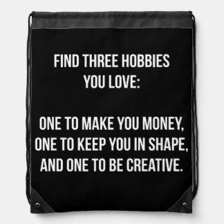Motivational Words - Find Three Hobbies You Love Drawstring Backpacks