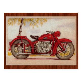 Motocicleta del rojo del vintage postal