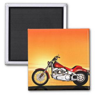 Motocicleta en la puesta del sol imán