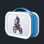 "Motocross Jump Lunch Box<br><div class=""desc"">Motocross sailing through the sky over a jump.</div>"