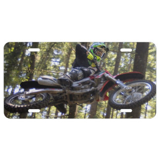 Motocross rider flying high in the trees license plate