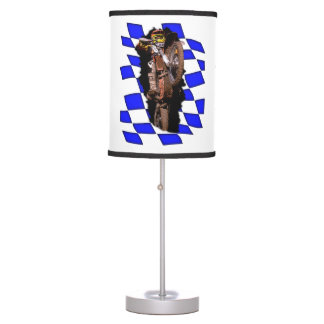 Motocross rider jumping out of blue checkered flag desk lamp