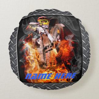 Motocross rider popping a wheelie through fire round pillow