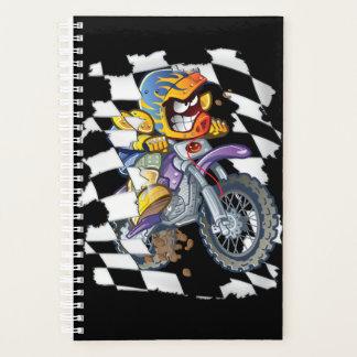 Motocross rider tearing through the checkered flag planner