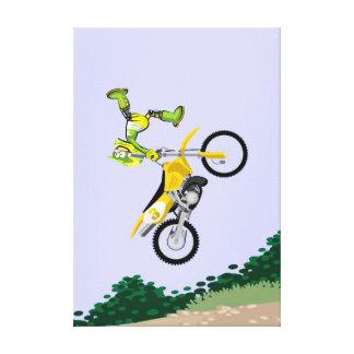 Motocross young shows dangerous acrobatics canvas print