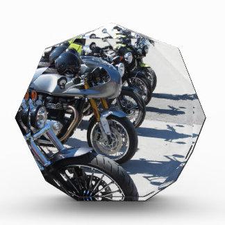 Motorcycles parked in row on asphalt acrylic award