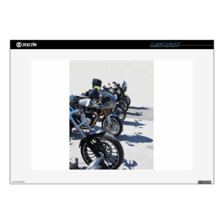 Motorcycles parked in row on asphalt decal for laptop