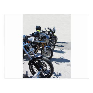 Motorcycles parked in row on asphalt postcard