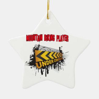 Motorista de la montaña bajo construcción adorno navideño de cerámica en forma de estrella