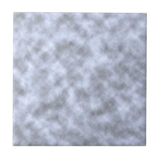 Mottled light blue black pattern background small square tile