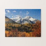 "Mount Timpanogos in Autumn Utah Mountains Jigsaw Puzzle<br><div class=""desc"">A puzzle with breathtaking Utah landscape photograph of  Mt. Timpanogos in the Fall . A beautiful snow capped mountain surrounded by autumn trees with leaves in warm yellows and golds and a vibrant blue sky with wisps of puffy clouds.</div>"