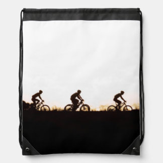 Mountain Bike Riders Make Their Way Over The Dam Drawstring Bag