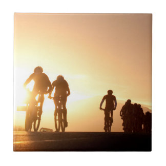 Mountain Bike Riders Make Their Way Over The Top Ceramic Tile